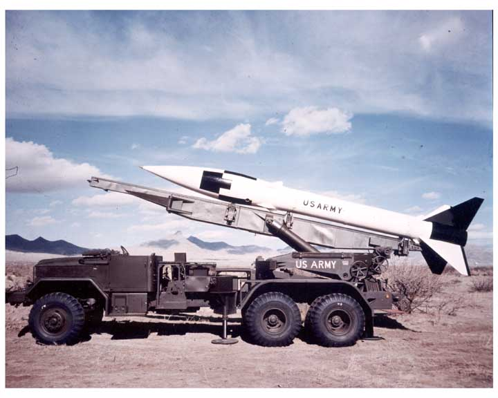 honest john rocket transported in an M35 military truck